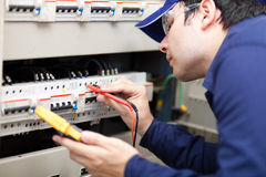 Young professional electrician while working Stock Photos