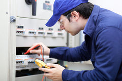 Young professional electrician while working Royalty Free Stock Images
