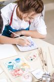 Young Professional Female Ceramist Glazing and Painting Ceramics. Young Professional Female Ceramist Glazing and Painting Ceramic Craft in Studio.Vertical Image Stock Images