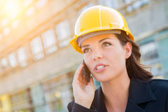 Young Professional Female Contractor Wearing Hard Hat at Contruc Royalty Free Stock Photography