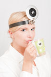 Young professional female doctor with coffie cup Stock Images