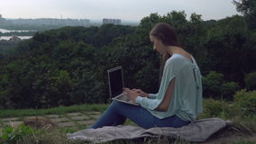 Young professional female using internet outdoors. stock video