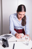 Young professional female is working under time pressure Royalty Free Stock Photo