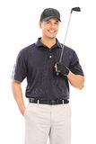 Young professional golfer posing. Isolated on white background Royalty Free Stock Photos
