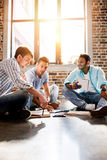 Young professional group working on new business project in small business office Royalty Free Stock Photos