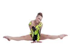 Young professional gymnast doing a splits isolated Royalty Free Stock Photography