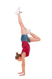 Young professional gymnast stand on arms over whit Royalty Free Stock Photos