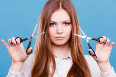 Young professional hairdresser with scissors. Royalty Free Stock Photos