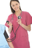 Young Professional Happy Relaxed Female Doctor Taking The Blood Pressure Of A Patient Royalty Free Stock Images