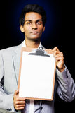 Young professional man with clipboard Stock Photography