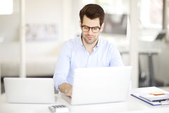 Young professional man at office Royalty Free Stock Photo
