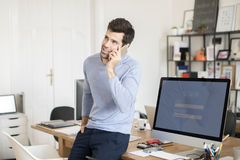 Young professional man in the office Stock Images