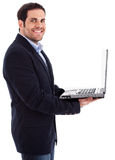 Young professional man smiling with a laptop Royalty Free Stock Image