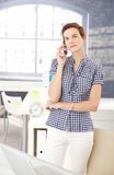 Young professional on mobile call Royalty Free Stock Image