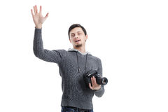 Young professional photographer with digital camera waving Hello Stock Image