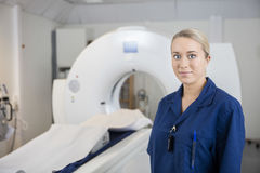 Young Professional Standing By MRI Machine In Clinic Stock Photos