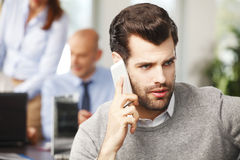 Young professional talking on cellphone Royalty Free Stock Photography