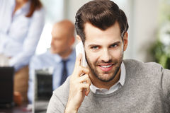 Young professional talking on cellphone Stock Photography