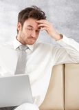 Young professional using laptop Royalty Free Stock Images