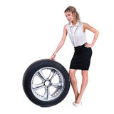 Young professional woman with car wheels. Caucasian businesswoman isolated on white background Royalty Free Stock Photography