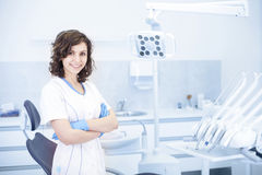 Young professional woman dentist in the dental office. Young professional woman dentist in the office on the background of the chair and dental accessories Royalty Free Stock Photo