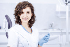 Young professional woman dentist in the dental office Stock Photos