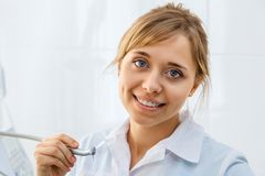 Young Woman Dentist with Dental Drill. Young Professional Woman Dentist in the Office with Dental Drill Royalty Free Stock Images