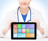 Young and professional woman doctor with an ipad Stock Photos