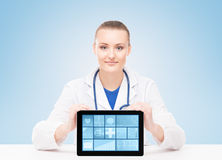 Young and professional woman doctor with a tablet Stock Image
