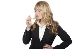 Young professional woman drinking water Stock Photography