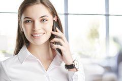Young professional woman with her cellphone Royalty Free Stock Photos