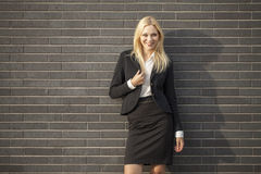 Young professional woman projecting confidence Stock Images