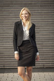 Young professional woman projecting confidence. Young professional in business attire projecting confidence against brick wall stock photography