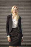 Young professional woman projecting confidence. Young professional in business attire projecting confidence against brick wall stock photos