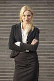 Young professional woman projecting confidence. Young professional in business attire projecting confidence against brick wall stock images