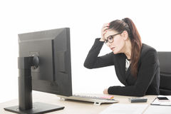 Young professional woman stressed and tired with headache sittin Royalty Free Stock Photos