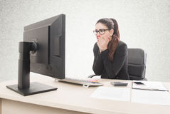 Young professional woman stressed and tired with headache sittin Royalty Free Stock Image