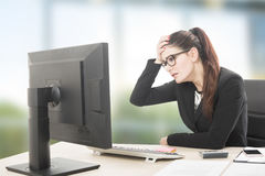 Young professional woman stressed and tired with headache sittin Stock Photography