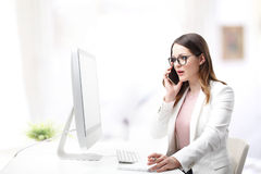 Young professional woman using mobile phone stock images