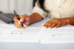 Young professional working on documents royalty free stock photography