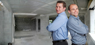 Young professionals in a construction site Stock Photos