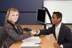 Young Professionals Handshaking on a Deal Stock Photography