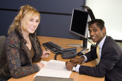Young Professionals Signing a Contract Royalty Free Stock Images