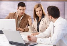 Young professionals teamworking in meeting room Royalty Free Stock Photography