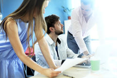 Young professionals work in modern office. Blurred,sunlights Stock Image