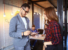 Young professionals work in modern office.Business crew working with startup Royalty Free Stock Photos