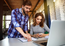 Young professionals work in modern office.Business crew working with startup Royalty Free Stock Image