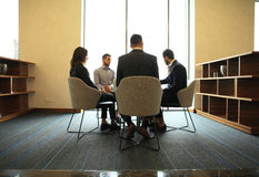 Young professionals work in modern office.Business crew working with startup. Royalty Free Stock Images