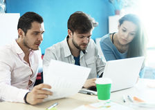 Young professionals work in modern office.Business crew working with startup Stock Image