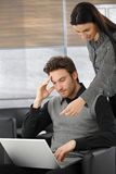 Young professionals working on laptop Royalty Free Stock Photography